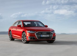 2018 Audi A8 volcano red front quarter
