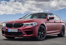 2018 bmw m5 first edition frozen dark red metallic front quarter