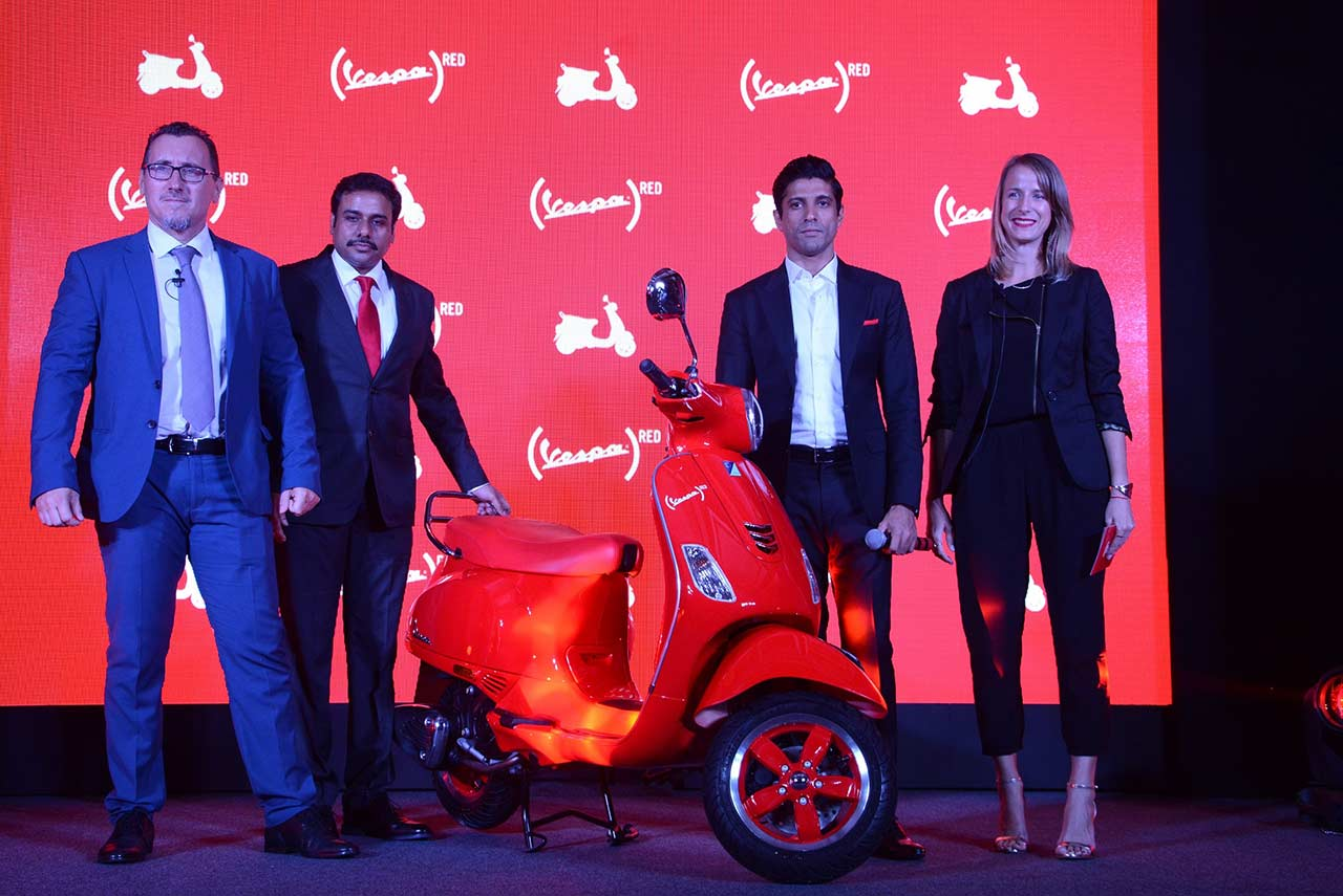 vespa red scooter price with bollywood actor farhan akhtar in india