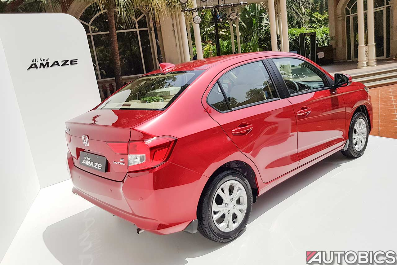 honda amaze radiant red  rear quarter autobics